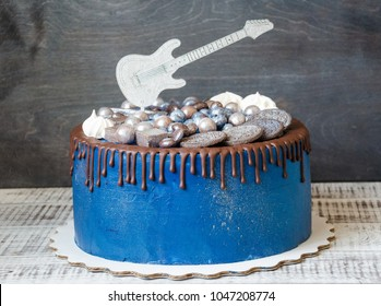 Cake With Sweets Cookies Blueberries And Guitar Topper