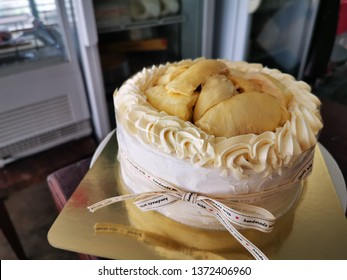 Durian Cake, Thai fruit Cake. It is on wooden table in bekery room.close up view.