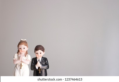 Cake topper Catholic holy communion ceremony religious boy and girl praying to Christian God in church.