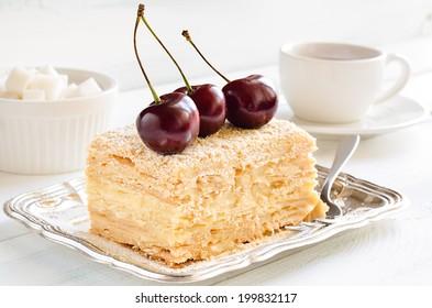 Cake with vanilla custard served with fresh summer cherries