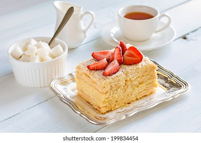 Cake with vanilla custard served with fresh summer strawberries