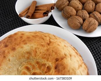 cake, walnut and cinnamon on white plate