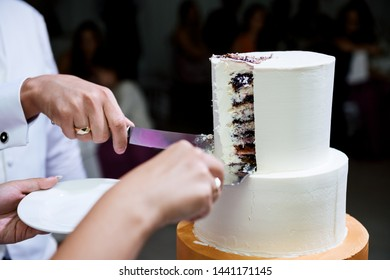 Cake at the wedding cut the bride and groom