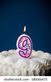 Cake: White Iced Birthday Cake With Candles For 9th Birthday