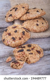 Cakes of healthy cereal with dried fruits on a rustic table