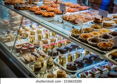 Cakes on display in patisserie shop window