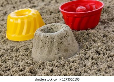 Cakes in the sandbox, close-up