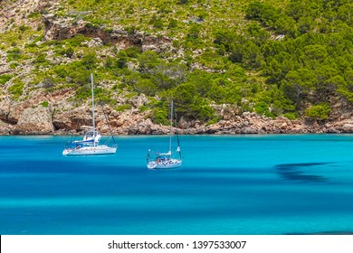 Cala Algaiarens Сove with Yachts Floating on Water at Menorca Island, Spain