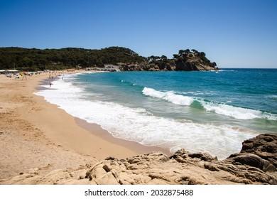 Cala de Castell in Costa Brava, sandy beach with sea in Palamos, Spain