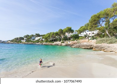 Cala d'Or, Mallorca, Spain - AUGUST 2016 - A young boy playing in the water at the beach of Cala d'Or
