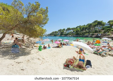 Cala d'Or, Mallorca, Spain - AUGUST 2016 - Tourists relaxing at the beach of Cala d'Or
