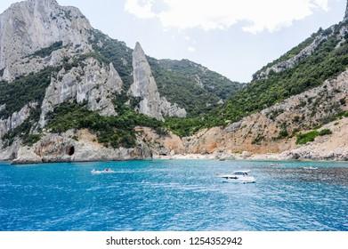 Cala Goloritze, Italy - 28 June 2013: people swimming and sunbathing at Cala Goloritze beach on Sardinia, Italy