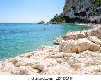 Cala Luna, Italy - 28 June 2013: people swimming and sunbathing at Cala Luna beach on Sardinia, Italy