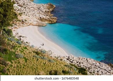 Cala Marinella. Paradise sea bay with azure water and beach view from coastline trail of Zingaro Nature Reserve Park, between San Vito lo Capo and Scopello, Trapani, Sicily, Italy