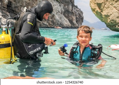 Cala Mariolu, Italy - 28 June 2013: Child discover scuba diving at Cala Mariolu beach on Sardinia, Italy