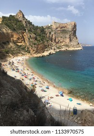 Cala Moraig in Javea sunny Spain on a sunny day with blue skies and blue sea June 2017