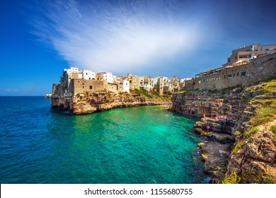 Cala Porto, also known as Lama Monachile beach and the surrounding architecture in the old town of Polignano a Mare, Puglia, Italy