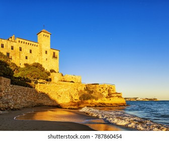 Cala Tobera bay with Tamarit castle overlooking the Mediterranean, Tarragona, Spain