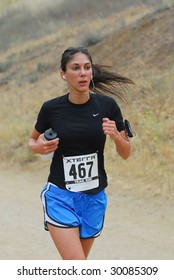 CALABASAS, CA - May 9, 2009: Mana Alison of  Los Angeles competes in the XTERRA Trail Race in Malibu Creek State park on May 9, 2009 in Calabasas, CA.