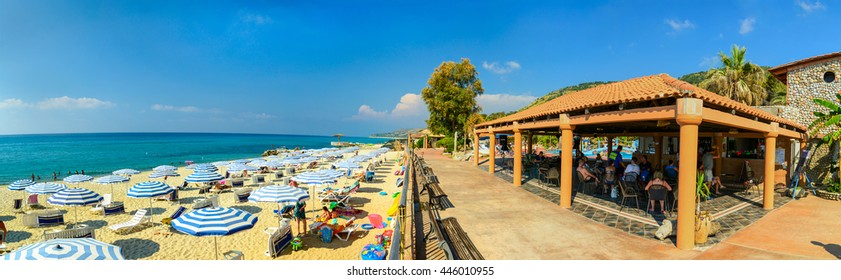 CALABRIA,ITALY, JULY 25: panoramic view of a beach bar and sun shades on a beach on July 25, 2013 in Calabria, Italy.