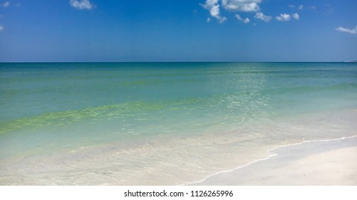 Caladesi island, Florida, USA - White sand beach with blue green waves in Caladesi island