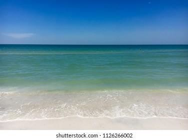 Caladesi island, Florida, USA: White sand beach with blue green waves in Caladesi island