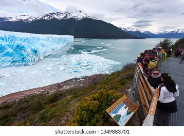 CALAFATE, ARGENTINA-NOVEMBER 23, 2014: People watching the collapses on the glacier located in the Los Glaciares National Park in the south west of Santa Cruz province, Argentina on November 23, 2014