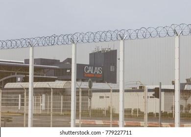 Calais, France, December 20, 2017: Entrance to Calais ferry terminal behind security fence in Calais.
