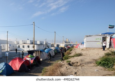 """Calais, France - October 13 2016: refugee camp """"Jungle"""" in Calais, with tents and makeshift shelters."""