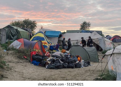 CALAIS, FRANCE - OCTOBER 24, 2016: Refugees in the Jungle of Calais during the eviction of the illegal refugee camp in the north of France.