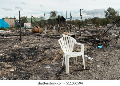 CALAIS, FRANCE - OCTOBER 27, 2016: A big part of the Jungle of Calais burned down during the eviction of the illegal refugee camp in the north of France.