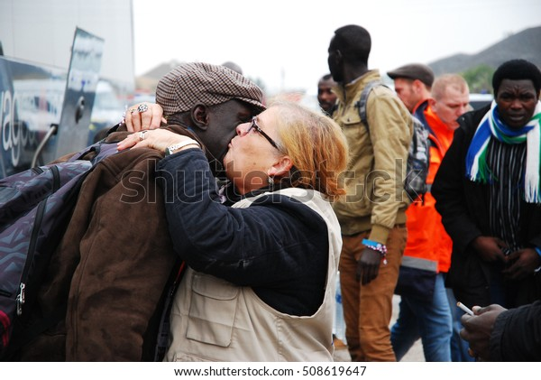 Calais - October 27, 2016: Refugee say goodby to a voluntair near the Jungle of Calais during the eviction of the illegal refugee camp in the north of French