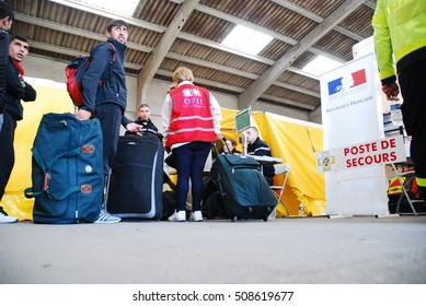 Calais - October 27, 2016: Refugees get processed in the hangar near the Jungle of Calais during the eviction of the illegal refugee camp in the north of French