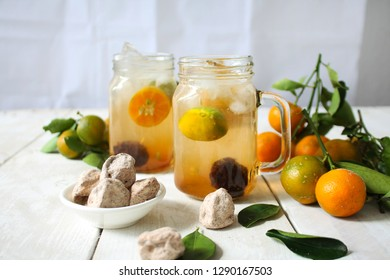 Calamansi lime juice. Malaysian popular drink, a mixed of Calamansi lime juice with sweet and sour plum served hot or cold.