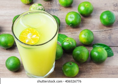 Calamansi lime juice on a wooden table