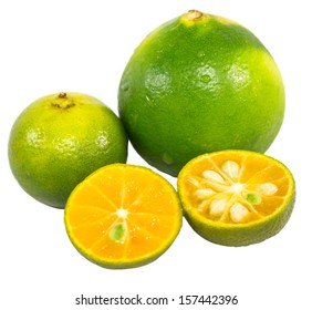 Calamansi and lime over white background