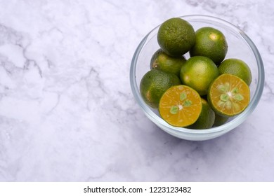 Calamansi on white marble background
