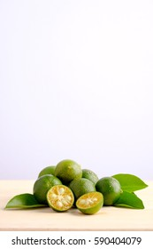 Calamansi on wooden table and white background