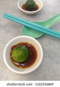 Calamansi with sliced chilli in soy sauce.
