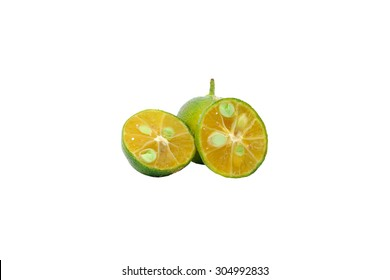 Calamondin or calamansi lime on a white background. Slightly defocused and close-up shot.
