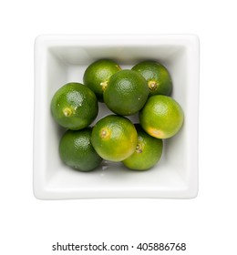 Calamondin fruits in a square bowl isolated on white background