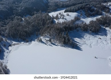 Calamone lake frozen and covered with snow at the foot of Mount Ventasso in the National Park of the Tuscan-Emilian Apennines, Ramiseto, Reggio Emilia, Italy