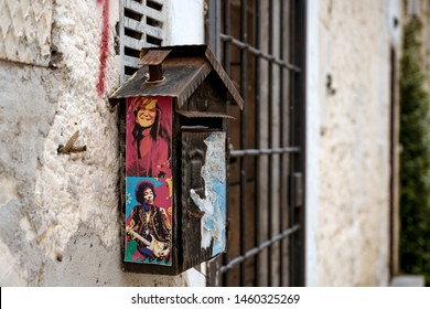 Calcata, Italy - May 2019: Mailbox with stickers from Jimi Hendrix and Janis Joplin