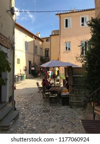 CALCATA, LATIUM, ITALY - SEPTEMBER 9, 2018: People enjoying a glass of wine and good local food in an outdoor restaurant.