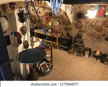 CALCATA, LATIUM, ITALY - SEPTEMBER 9, 2018: Small antiquities store in the building underground, selling various antique items as souvenirs.