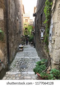 CALCATA, LATIUM, ITALY - SEPTEMBER 9, 2018: Old street with buildings in tuff in the center of this small medieval settlement, a low-key attraction which offers a taste of an alternative Italy.