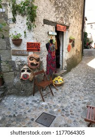 CALCATA, LATIUM, ITALY - SEPTEMBER 9, 2018: Artistic crafts store with colorful products displayed outside in the street.