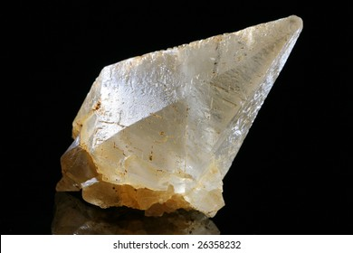 calcite clear scalahedron crystal on the black background