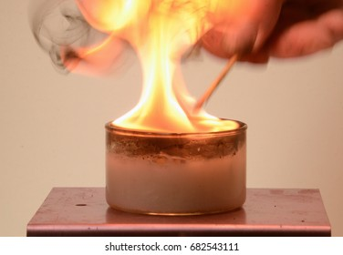 Calcium Carbide dissolves in water, creating Acetylene gas. This rather explosive gas burns with a yellow flame .