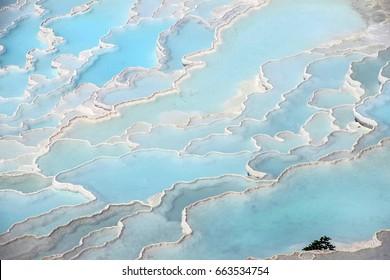 Calcium deposits  on travertine turquoise  terraces at  Pamukkale,  Turkey